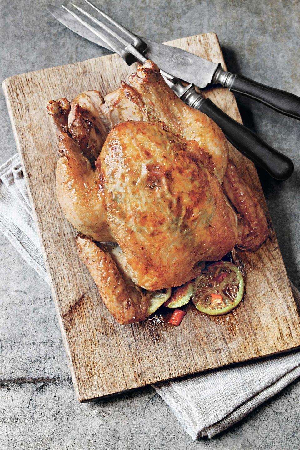 "<p>Succulent, golden-skinned chicken with cooked apples makes a memorable and mouthwatering meal.</p><p><strong><a href=""https://www.countryliving.com/food-drinks/recipes/a1041/apple-sage-roastedchicken-panjuices-3148/"" rel=""nofollow noopener"" target=""_blank"" data-ylk=""slk:Get the recipe"" class=""link rapid-noclick-resp"">Get the recipe</a>.</strong></p>"