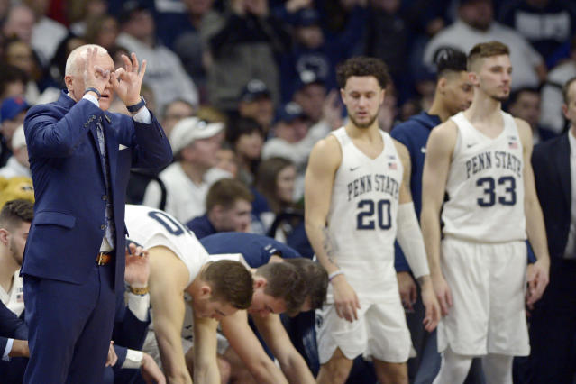 Penn State coach Patrick Chambers gives a signal from the bench during the second half of an NCAA college basketball game against Northwestern, Saturday, Feb. 15, 2020, in State College, Pa. (AP Photo/Gary M. Baranec)