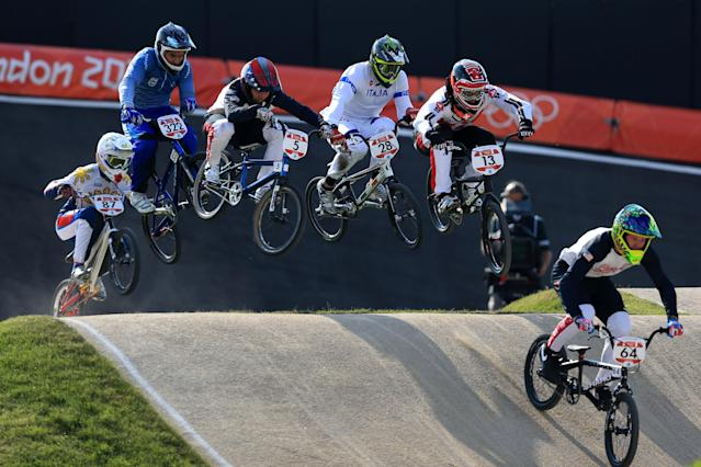LONDON, ENGLAND - AUGUST 09: Nicholas Long (R) of the United States leads the field down a jump during the Men's BMX Cycling Quarter Finals on Day 13 of the London 2012 Olympic Games at BMX Track on August 9, 2012 in London, England. (Photo by Phil Walter/Getty Images)