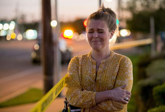 <p>Caity Colvard gets emotional as she watches a massive response of law enforcement officers at a bomb explosion site at a Goodwill store in Austin, Texas, on Tuesday March 20, 2018. (Photo: Jay Janner/Austin American-Statesman via AP) </p>