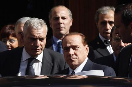 Italian center-right leader Berlusconi leaves the Senate in Rome