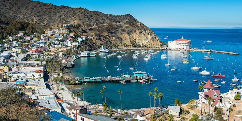 """<p><strong>Best Island Getaway</strong><br></p><p>If you really want to get away from it all, hop aboard a ferry from Long Beach to idyllic <a href=""""https://go.redirectingat.com?id=74968X1596630&url=https%3A%2F%2Fwww.tripadvisor.com%2FTourism-g102873-Catalina_Island_California-Vacations.html&sref=https%3A%2F%2Fwww.redbookmag.com%2Flife%2Fg37132327%2Ftop-california-beach-vacations%2F"""" rel=""""nofollow noopener"""" target=""""_blank"""" data-ylk=""""slk:Catalina Island"""" class=""""link rapid-noclick-resp"""">Catalina Island</a>. Avalon, the island's largest town, has a postcard-perfect harbor dotted with sailboats, and the main strand is Crescent Beach, which is comprised of three small beaches. While you won't find wide sandy stretches, the view of the harbor and surrounding cliffs more than makes up for it. </p><p><strong><em>Where to Stay: </em></strong><a href=""""https://go.redirectingat.com?id=74968X1596630&url=https%3A%2F%2Fwww.tripadvisor.com%2FHotel_Review-g29121-d196399-Reviews-Portofino_Hotel-Avalon_Catalina_Island_California.html&sref=https%3A%2F%2Fwww.redbookmag.com%2Flife%2Fg37132327%2Ftop-california-beach-vacations%2F"""" rel=""""nofollow noopener"""" target=""""_blank"""" data-ylk=""""slk:Portofino Hotel"""" class=""""link rapid-noclick-resp"""">Portofino Hotel</a>, <a href=""""https://go.redirectingat.com?id=74968X1596630&url=https%3A%2F%2Fwww.tripadvisor.com%2FHotel_Review-g188644-d228077-Reviews-Hotel_Metropole-Brussels.html&sref=https%3A%2F%2Fwww.redbookmag.com%2Flife%2Fg37132327%2Ftop-california-beach-vacations%2F"""" rel=""""nofollow noopener"""" target=""""_blank"""" data-ylk=""""slk:Hotel Metropole"""" class=""""link rapid-noclick-resp"""">Hotel Metropole</a></p>"""