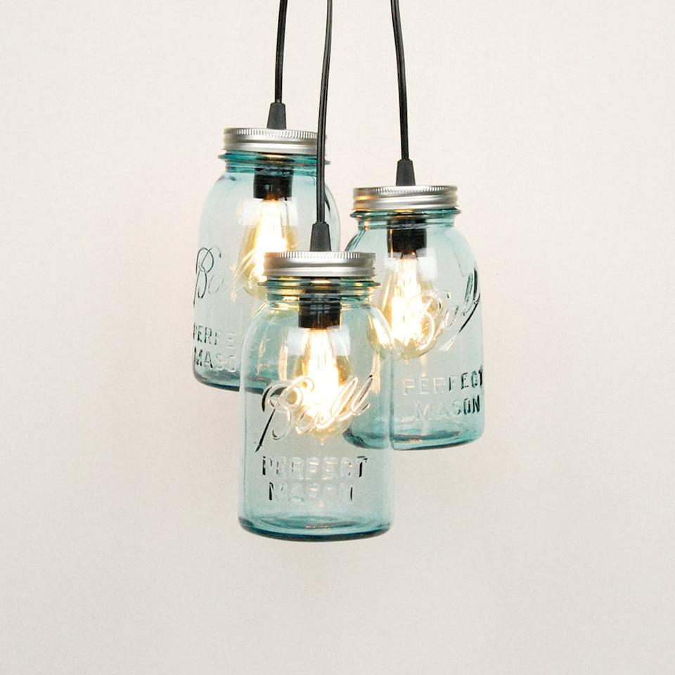"<p>With a bit of work, you can make rustic chandeliers out of mason jars. For an easier <a class=""sugar-inline-link ga-track"" title=""Latest photos and news for DIY"" href=""https://www.popsugar.com/DIY"" target=""_blank"" data-ga-category=""Related"" data-ga-label=""https://www.popsugar.com/DIY"" data-ga-action=""&lt;-related-&gt; Links"">DIY</a> route, use candles instead of electrical lighting. </p> <p>Buy this <a href=""https://www.popsugar.com/buy/mason-jar-chandelier-539171?p_name=mason%20jar%20chandelier&retailer=etsy.com&pid=539171&price=90&evar1=savvy%3Aus&evar9=24338804&evar98=https%3A%2F%2Fwww.popsugar.com%2Fphoto-gallery%2F24338804%2Fimage%2F25011090%2FMason-Jar-Chandelier&list1=diy%2Ceco%2Cupcycling%2Cbudget%20tips&prop13=api&pdata=1"" rel=""nofollow"" data-shoppable-link=""1"" target=""_blank"" class=""ga-track"" data-ga-category=""Related"" data-ga-label=""https://www.etsy.com/listing/231251340/mason-jar-chandelier-3-vintage-quart"" data-ga-action=""In-Line Links"">mason jar chandelier</a> ($90) on Etsy.</p>"