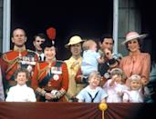 The Queen, Prince Philip, Princess Anne, Prince Charles with baby Harry, Princess Diana and Prince William (centre) watch the fly-past from the balcony. (PA Images)