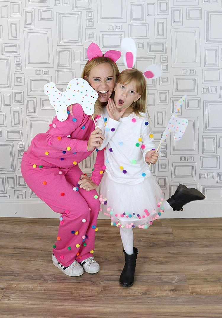 """<p>Could this duo be more adorable? Add pom-poms to pink sweats and a white T-shirt to recreate this fun idea with your mini-me. </p><p><strong>See more at <a href=""""https://christinawilliamsblog.com/easy-last-minute-costume/"""" rel=""""nofollow noopener"""" target=""""_blank"""" data-ylk=""""slk:Christina Williams Designs"""" class=""""link rapid-noclick-resp"""">Christina Williams Designs</a>. </strong></p><p><a class=""""link rapid-noclick-resp"""" href=""""https://amazon.com/Caydo-Assorted-Multicolor-Supplies-Creative/dp/B07FFM3DPB/ref=pd_lpo_sbs_201_img_1?tag=syn-yahoo-20&ascsubtag=%5Bartid%7C10050.g.29402076%5Bsrc%7Cyahoo-us"""" rel=""""nofollow noopener"""" target=""""_blank"""" data-ylk=""""slk:SHOP POM-POMS"""">SHOP POM-POMS</a></p>"""
