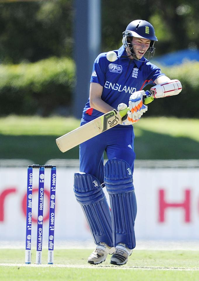 TOWNSVILLE, AUSTRALIA - AUGUST 11:  Ben Collins of England avoids a bouncer during the ICC U19 Cricket World Cup 2012 match between Australia and England at Tony Ireland Stadium on August 11, 2012 in Townsville, Australia.  (Photo by Ian Hitchcock-ICC/Getty Images)