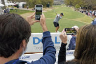 Fans film Jordan Spieth as he tees off on the 12th hole during a practice round for the Dell Technologies Match Play Championship golf tournament Monday, March 22, 2021, in Austin, Texas. (AP Photo/David J. Phillip)