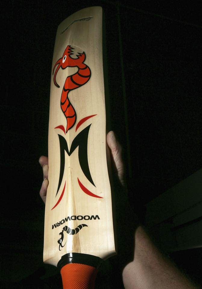 "HUNTINGDON, UNITED KINGDOM - SEPTEMBER 07:  The Andrew ""Freddie"" Flintoff' signature 'Woodworm Flame' cricket bat is held aloft by the batmaker, September 7, 2005 in Huntingdon, England.  Ashes fever continues to grip the country as England and Australia are currently in preparation for the final Ashes Test at the Oval Cricket ground that starts tomorrow.  (Photo by Bruno Vincent/Getty Images)"