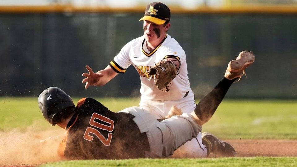 Bishop Kelly third baseman Hadley Smith tags out Ridgevue's Nathan Rice in the 4A District Three baseball championship Thursday at Vallivue High School in Caldwell.