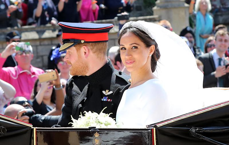 Prince Harry, Duke of Sussex and the Duchess of Sussex in the Ascot Landau carriage during the procession after getting married at St George's Chapel, Windsor Castle on May 19, 2018 in Windsor, England. (WPA Pool via Getty Images)