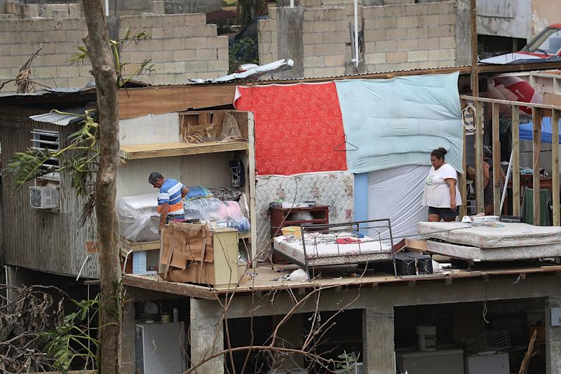 Jose Bernard and his daughter Yolymar salvage what they can from their home in Corozal, Puerto Rico, on Wednesday. (Joe Raedle via Getty Images)