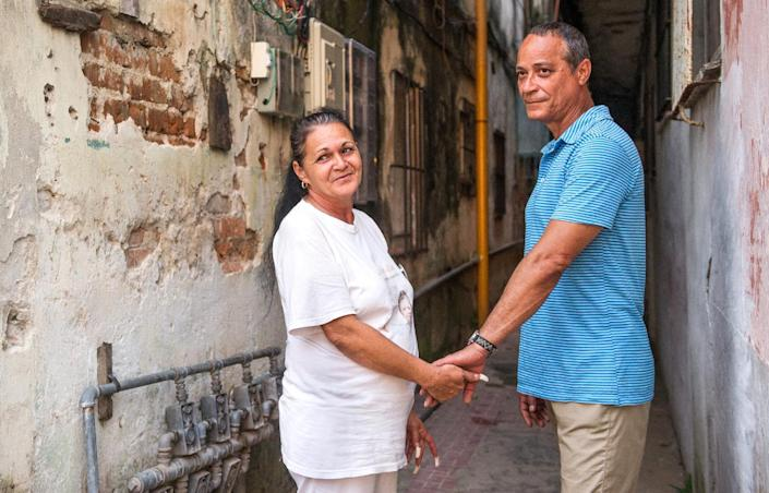 Cuban dissident Angel Figueredo (R) and his wife, Haydee Gallardo (L), pictured on January 12, 2015, in Havana. The couple were released from prison as part of an agreement aimed at ending decades of hostility between Cuba and the US (AFP Photo/Yamil Lage)