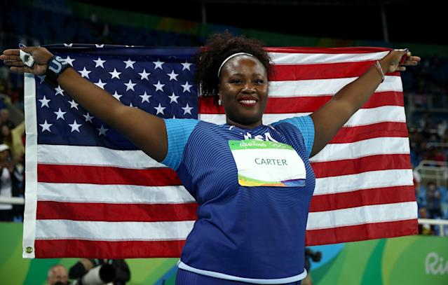 <p>Michelle Carter of the United States celebrates placing first in the Women's Shot Put Final on Day 7 of the Rio 2016 Olympic Games at the Olympic Stadium on August 12, 2016 in Rio de Janeiro, Brazil. (Photo by Cameron Spencer/Getty Images) </p>