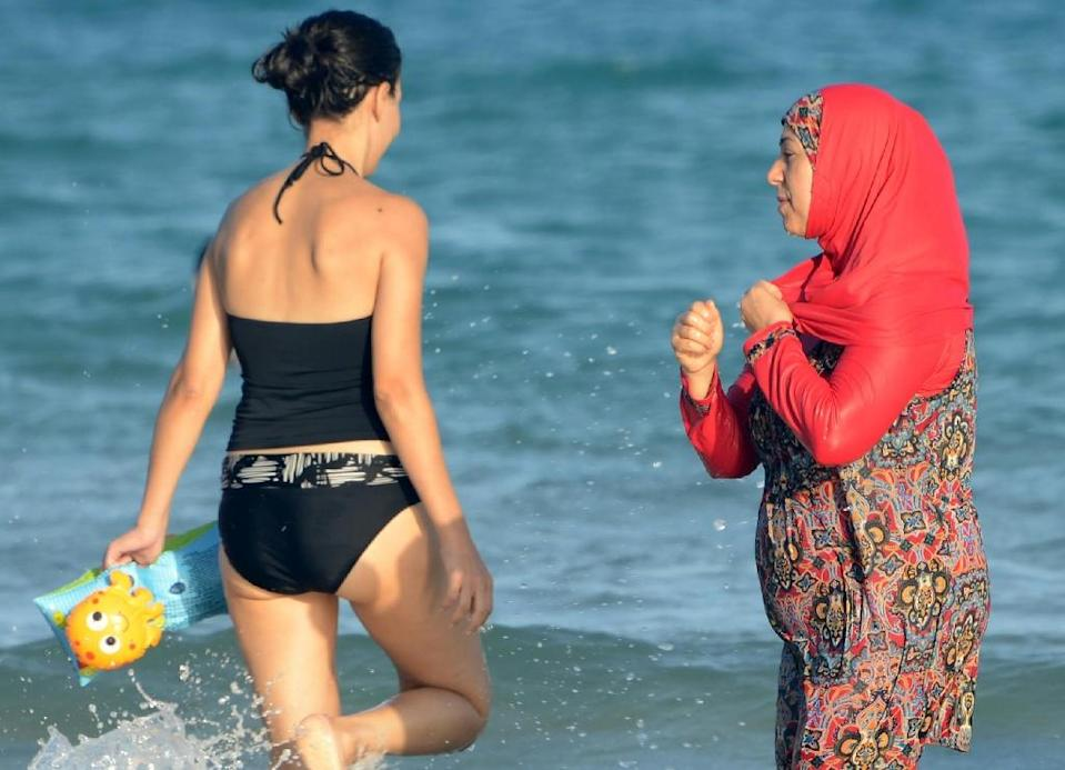 Nice was one of the first French towns to ban the burkini Islamic swimsuit (pictured right) this summer (AFP Photo/Fethi Belaid)