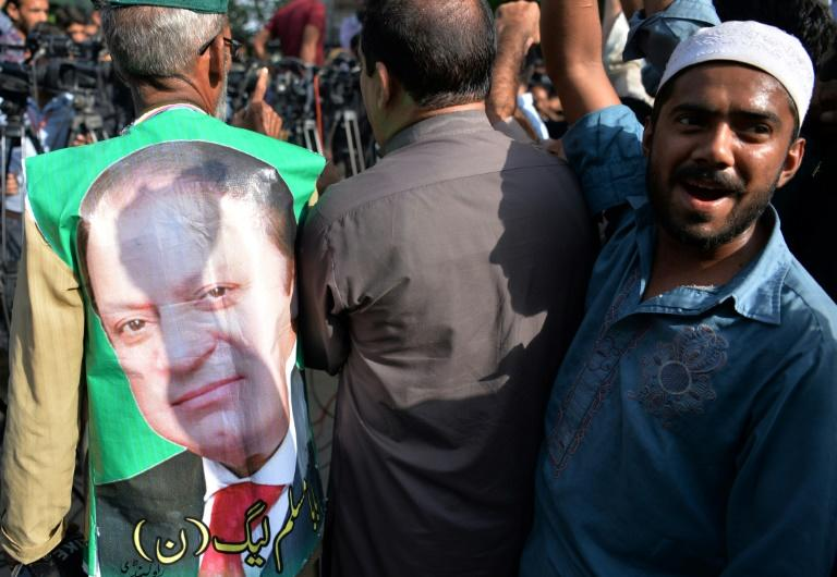A Pakistani supporter of ousted prime minister Nawaz Sharif shouts slogans  outside the high court in Islamabad