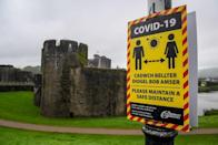 Covid-19 signage opposite Caerphilly castle (Ben Birchall/PA)