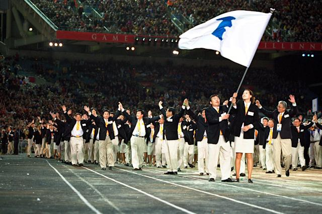 15 Sep 2000: The two Korean Olympic teams walk round together under the same flag in a gesture of reconciliation during the Opening Ceremony of the Sydney 2000 Olympic Games at the Olympic Stadium in Homebush Bay, Sydney, Australia. Mandatory Credit: Jed Jacobsohn /Allsport