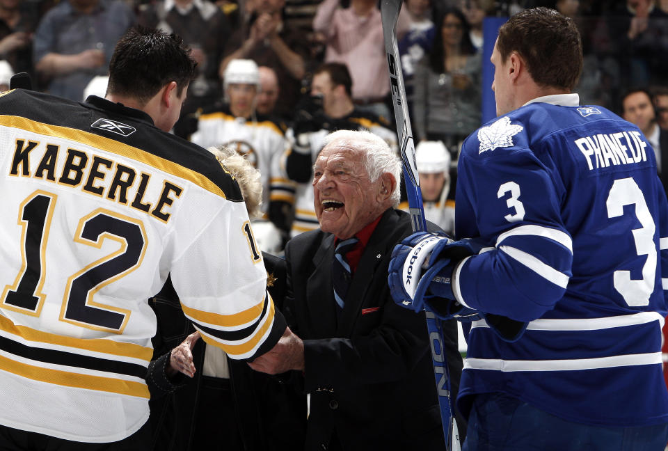 TORONTO, CANADA - MARCH 19: Howie Meeker shakes Tomas Kaberle #12 of the Boston Bruins' hand with Dion Phaneuf #3 of the Toronto Maple Leafs before game action at the Air Canada Centre March 19, 2011 in Toronto, Ontario, Canada. (Photo by Abelimages/Getty Images)