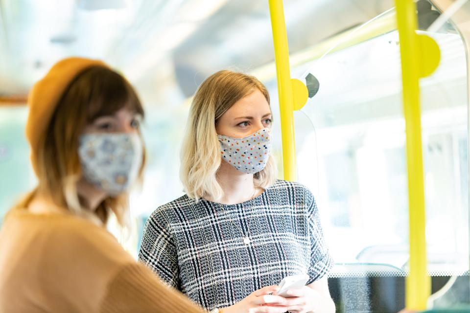 <p>Go-Ahead passengers wearing face coverings</p> (Go-Ahead)