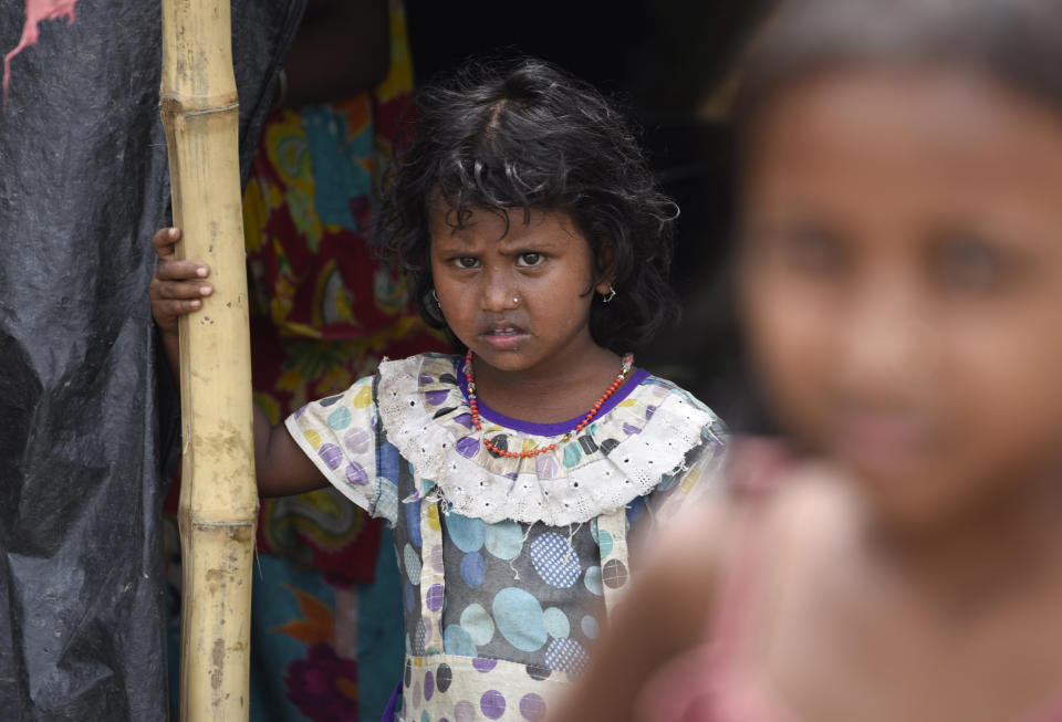 A girl in a makeshift shelter on road at a flood-affected village in Morigaon district of Assam in India, Friday, July 17, 2020. (Photo by David Talukdar/NurPhoto via Getty Images)