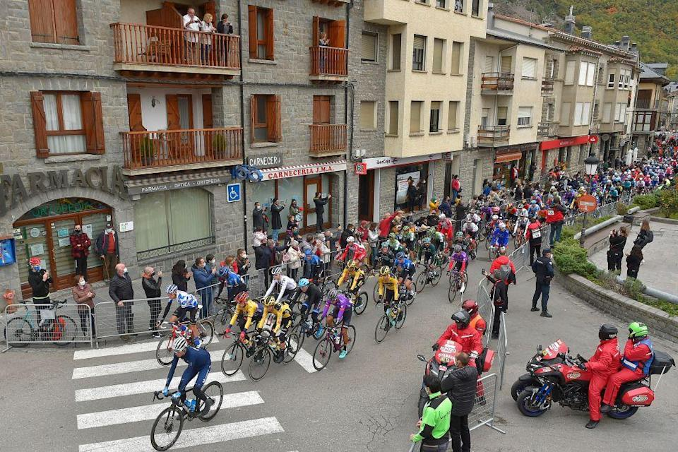 Cyclists take the start of the 6th stage of the 2020 La Vuelta cycling tour of Spain a 1464km race from Biescas to Formigal on October 25 2020 Photo by ANDER GILLENEA  AFP Photo by ANDER GILLENEAAFP via Getty Images