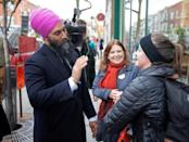 NDP leader Jagmeet Singh is greeted by supporters during an election campaign visit in Montreal
