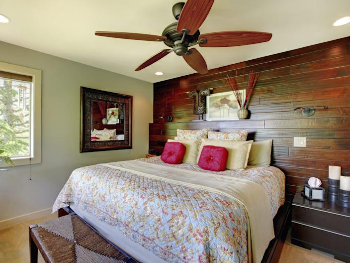 wood accent wall bedroom ceiling fan plant