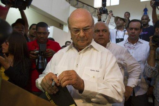 The presidential candidate for the Dominican Revolutionary Party, Hipolito Mejia, gets ready to cast his vote