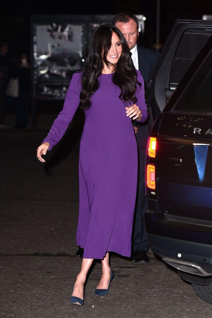 <p>The long-sleeve sheath dress that Meghan Markle wore to an event at Royal Albert Hall in 2019 may have a more modern design than Rapunzel's dress, but it's hard not to draw similarities thanks to its deep purple hue. </p>