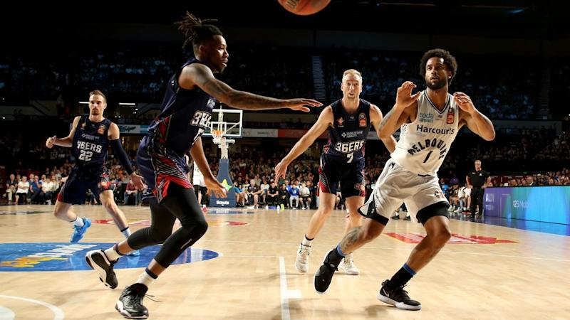 Adelaide big man Eric Griffin (left) looks to defend Melbourne star Melo Trimble in their NBL clash