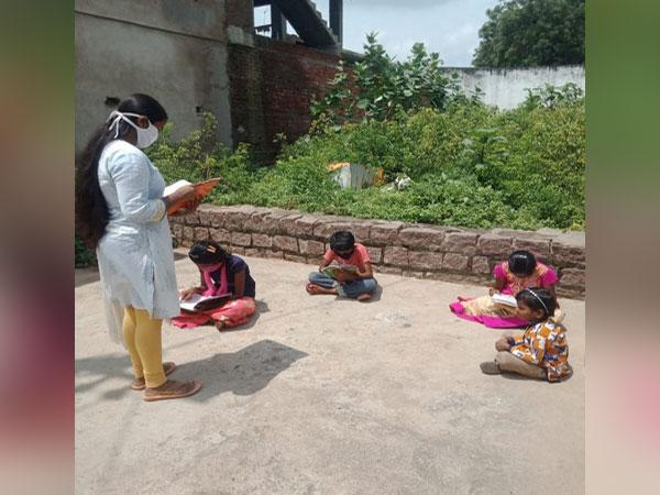 A Vidya Volunteer teaching students following COVID-19 norms in Hyderabad. (Photo/ANI)