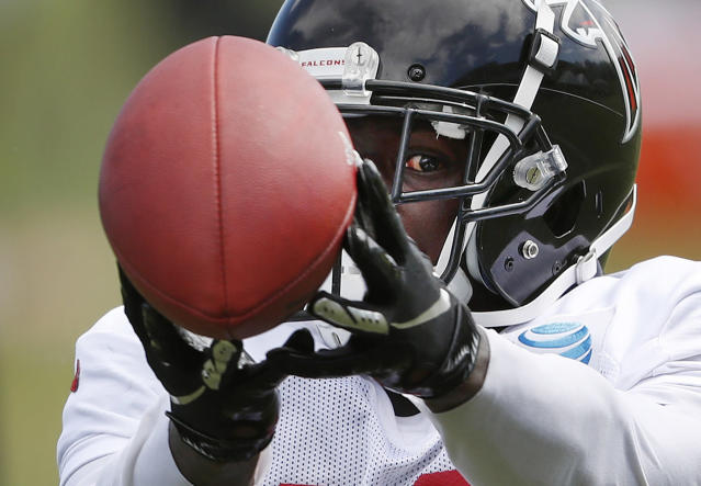 Atlanta Falcons wide receiver Calvin Ridley keeps an eye on the ball while making a catch during NFL football training camp, Tuesday, Aug. 7, 2018, in Flowery Branch, Ga. (AP Photo/John Bazemore)