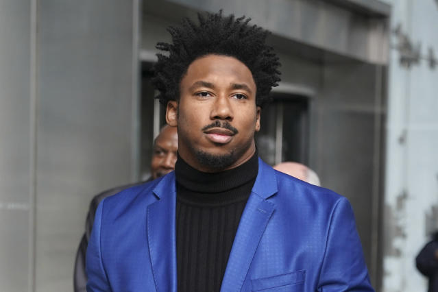 Browns end Myles Garrett leaves his suspension appeal hearing in New York. (AP Photo/Seth Wenig)