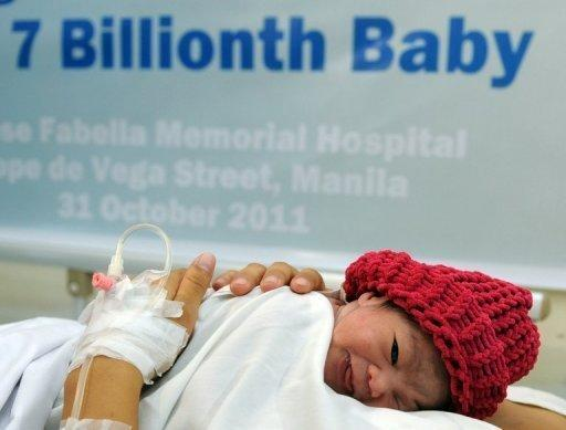 Danica Mae Camacho, the Philippine's symbolic 7 billionth baby is coddled by her mother Camille during a welcoming ceremony in Manila. The Philippines welcomed the world's symbolic seven billionth baby October 31 with a celebratory cheer at a packed government-run maternal hospital. Weighing 2.5 kilos, Danica May was delivered just shortly before midnight on October 30