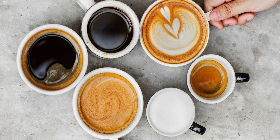 """<p>If you've ever turned up at a <a href=""""https://www.delish.com/uk/cocktails-drinks/a30596110/coffee-shops-near-me/"""" target=""""_blank"""">coffee shop</a> and found yourself wondering what the hell all those types of <a href=""""https://www.delish.com/uk/cocktails-drinks/a30116467/how-to-make-coffee/"""" target=""""_blank"""">coffees</a> on the menu are, then you're not alone, friend. Like, how is a doppio different to an espresso? And it a frappe hot or cold? And will you judge me for ordering a cappuccino seeing as it's not the 90s anymore (sidenote: a cappuccino is my <a href=""""https://www.delish.com/uk/kitchen-accessories/a32361471/coffee-shop-home/"""" target=""""_blank"""">coffee</a> of choice, so BACK OFF)?</p><p>To ease your mind next time you head into a Starbucks or <a href=""""https://www.delish.com/uk/cocktails-drinks/a32445056/pret-coffee-at-home/"""" target=""""_blank"""">Pret</a>, here's a guide to all the different types of <a href=""""https://www.delish.com/uk/cocktails-drinks/g32285762/coffee-subscription-uk/"""" target=""""_blank"""">coffees</a> you can order, so you know what to expect when the barista hands you your caffeine fix.</p><h4 class=""""body-h4"""">Types of coffee beans</h4><p>And before we get into the complexity of the different kinds of drinks you can make from coffees, here's a quick lesson on coffee beans.</p><p class=""""body-text""""><strong>Robusta beans</strong></p><p>Robusta beans are the lower quality of the two main coffee beans used across the world. Robbusta beans are far easier to grow, and you get a higher yield from them. These beans have more of an astringent flavour and contain a higher amount of caffeine.<strong><br></strong></p><p><strong>Arabica beans</strong></p><p>Arabica beans make up three quarters of all the coffee beans used throughout the world. This is because they are nicer, tbh. They have half the amount of caffeine as robusta beans, and have a more pleasing flavours and aromatic properties.</p>"""