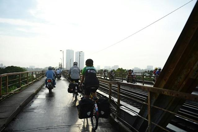 The pair have stayed mostly on schedule cycling though the European winter, along to Central and Southeast Asia, and on Sunday are heading north to China from Vietnam (AFP Photo/Nhac NGUYEN)