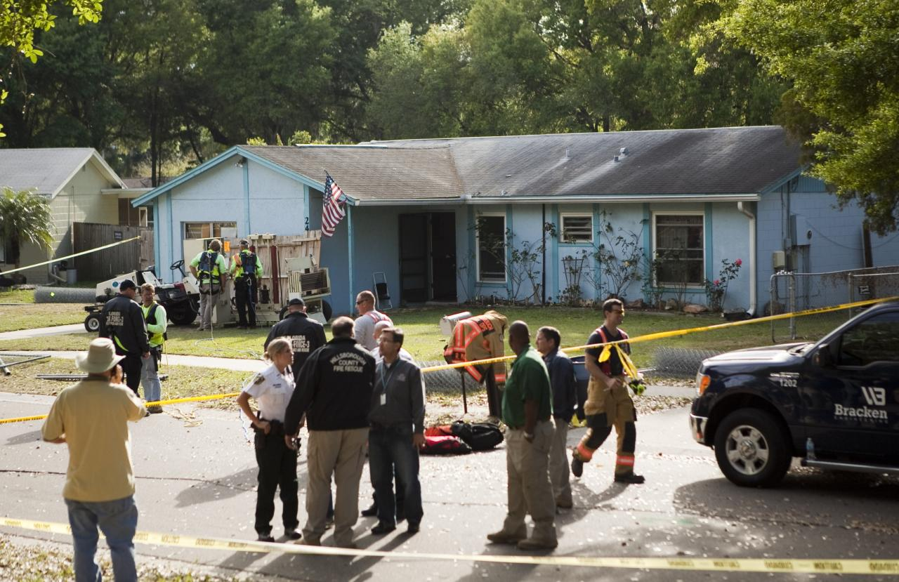 SEFFNER, FL - MARCH 1:  A crowd gathers at the home of Jeff Bush after he was consumed by a sinkhole while lying in bed last night, March 1, 2013 in Seffner, Florida. First responders were not able to reach Bush after he disappeared and now say it is a recovery mission. (Photo by Edward Linsmier/Getty Images)