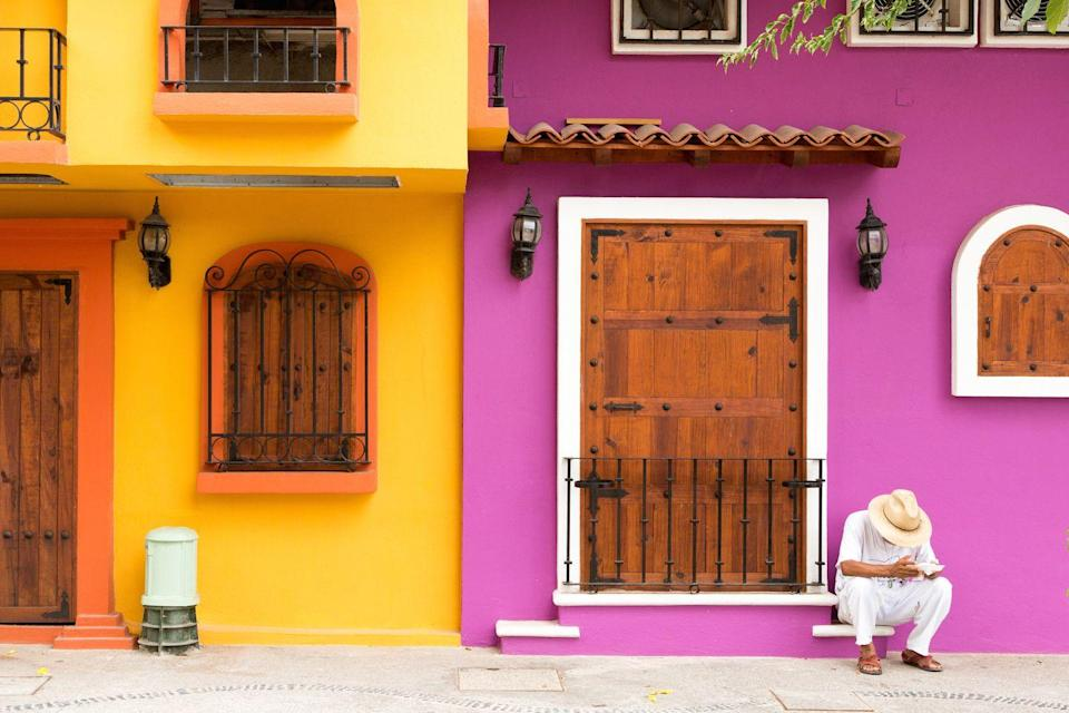 <p>The bold colors of Mexico are exaggerated on the walls on this home.</p>