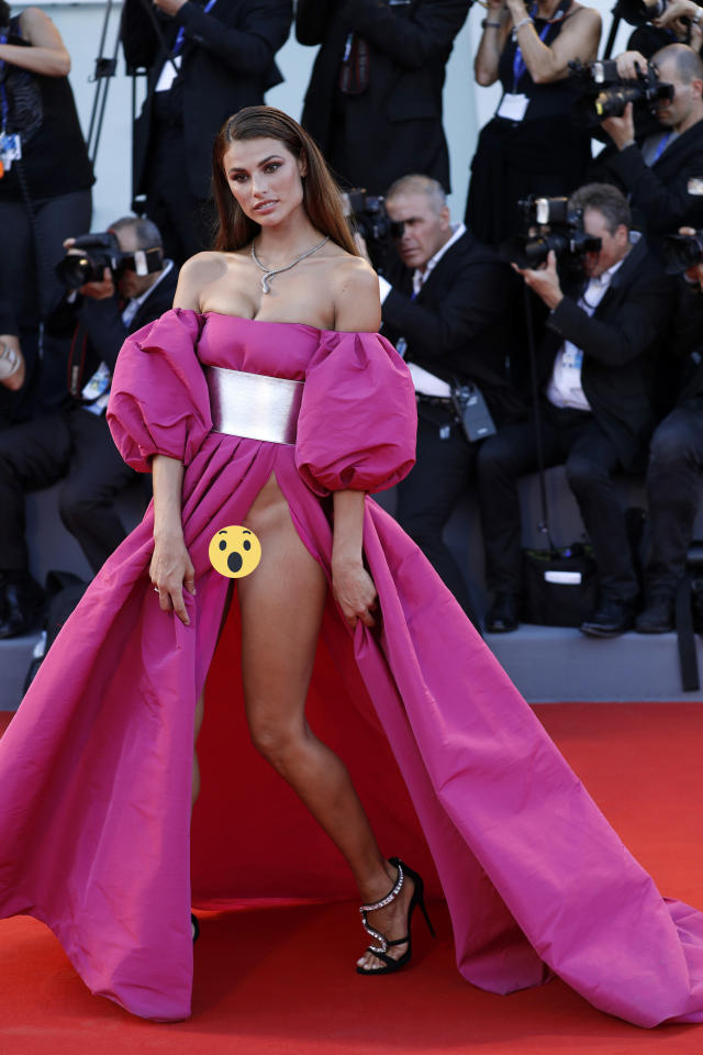 <p>The Brazilian model caused a stir at Venice Film Festival 2016 when she went knickerless in this racy dress - showing the world her lady parts. <i>[Photo: Getty]</i></p>