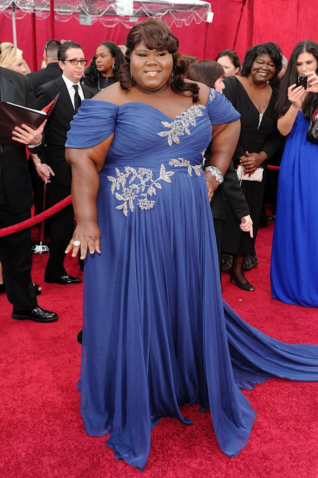 """Gabourey Sidibe   Grade: A-    The Best Actress nominee was absolutely """"Precious"""" while working it in a blue off-the-shoulder Marchesa creation. Gabourey also won some extra points for her sass: """"If fashion was porn, this dress is the money shot,"""" she laughed on the red carpet."""