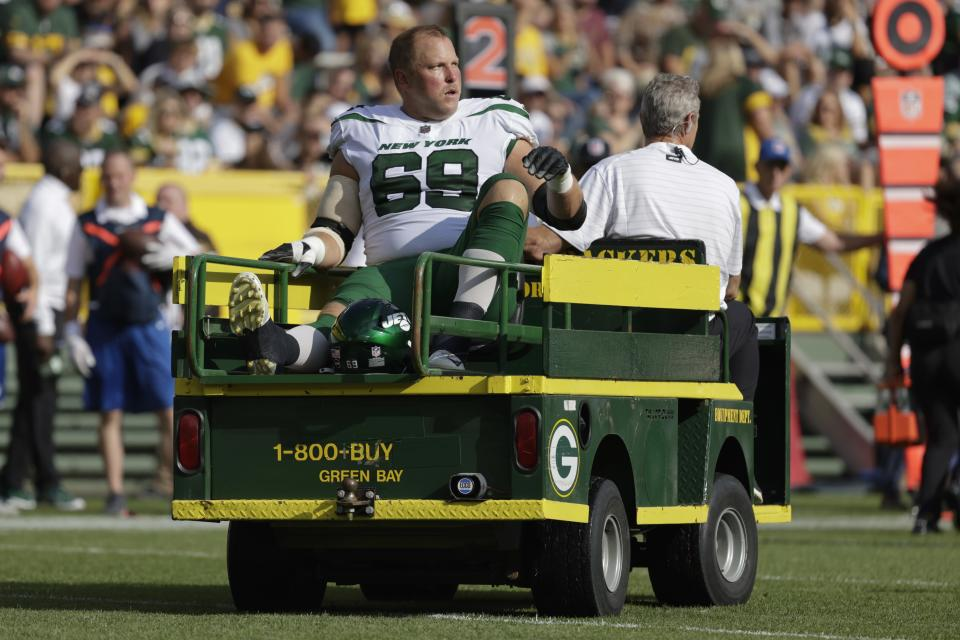 New York Jets' Conor McDermott is taken off the field on a cart after being injured during the first half of a preseason NFL football game against the New York Jets Saturday, Aug. 21, 2021, in Green Bay, Wis. (AP Photo/Mike Roemer)