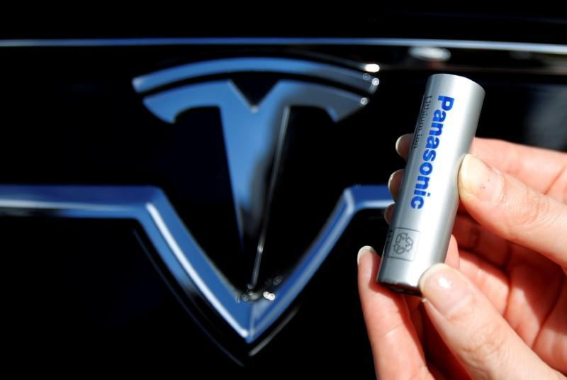 FILE PHOTO: A Panasonic Corp's lithium-ion battery is pictured with Tesla Motors logo in Tokyo