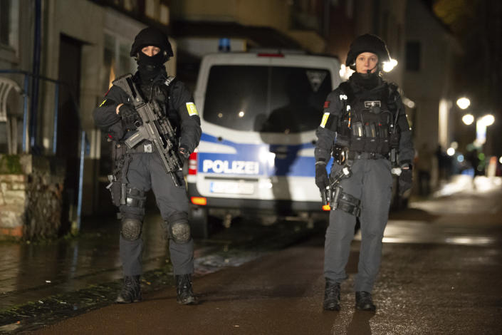 Armed police are seen at the site of a car crash during a carnival procession in Volkmarsen. (Swen Pfortner/dpa via AP)