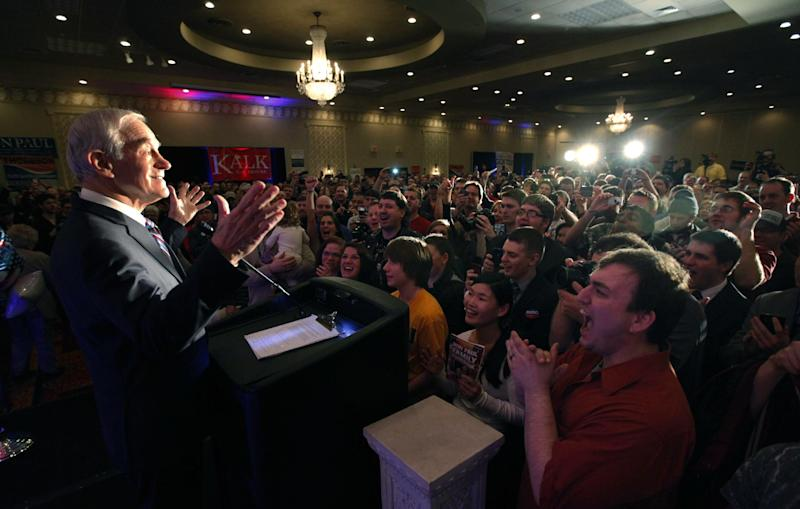 Republican presidential candidate Rep. Ron Paul, R-Texas, takes in the applause of the crowd as he address a crowd during the North Dakota caucus Tuesday, March 6, 2012, in Fargo, N.D. (AP Photo/Charles Rex Arbogast)