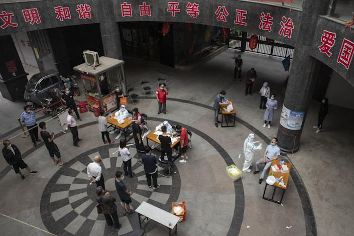 """People wait for coronavirus tests May 13, 2020. The lockdown on Wuhan lasted about three months, until April 8. <span class=""""copyright"""">(For The Times)</span>"""