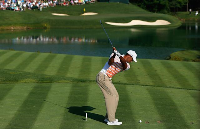 DUBLIN, OH - MAY 31: Tiger Woods hits his tee shot on the 12th hole during the second round of the Memorial Tournament presented by Nationwide Insurance at Muirfield Village Golf Club on May 31, 2013 in Dublin, Ohio. (Photo by Scott Halleran/Getty Images)