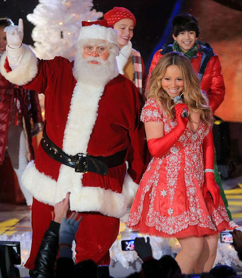 Mariah Carey performs with Santa Claus at the Rockefeller Center Tree Lighting in NYC.