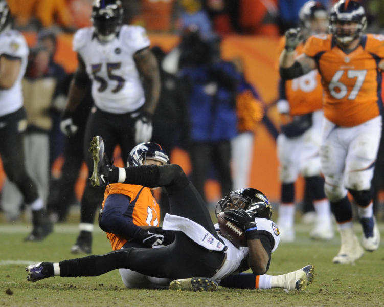 Baltimore Ravens cornerback Corey Graham (24) comes down with an interception of a pass intended for Denver Broncos wide receiver Brandon Stokley (14) in overtime of an AFC divisional playoff NFL football game, Saturday, Jan. 12, 2013, in Denver. (AP Photo/Jack Dempsey)