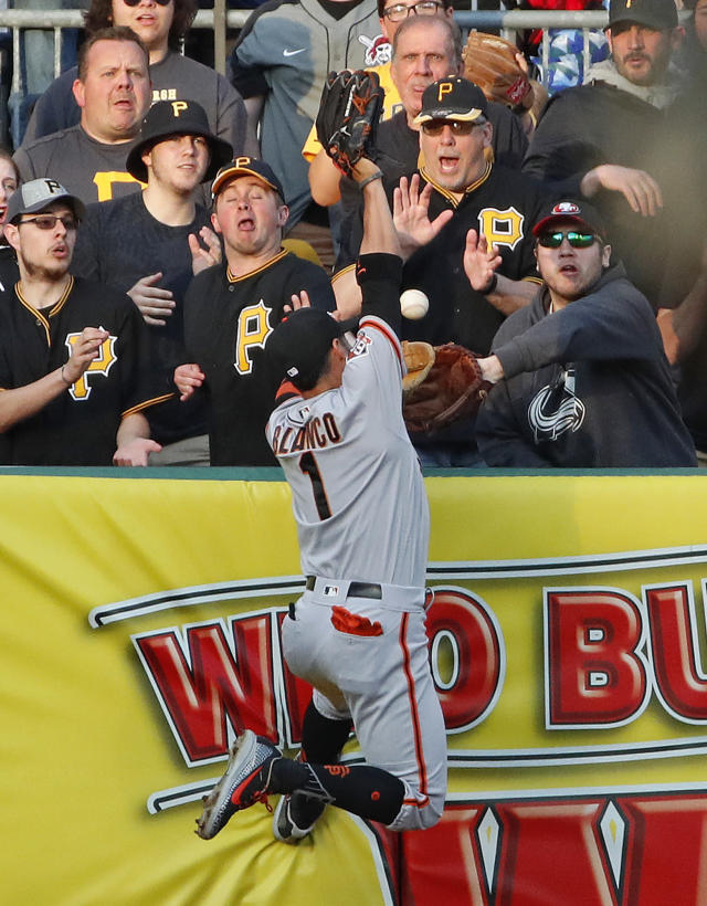San Francisco Giants left fielder Gregor Blanco (1) leaps for but cannot come up with a two-run home run by Pittsburgh Pirates' Starling Marte in the first inning of a baseball game in Pittsburgh, Friday, May 11, 2018. (AP Photo/Gene J. Puskar)