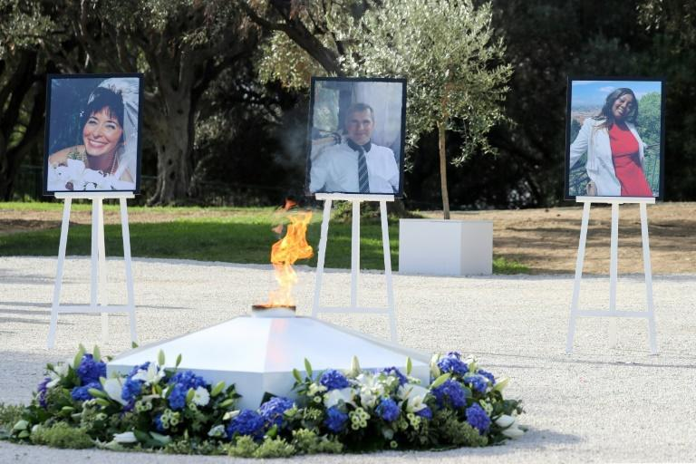 Portraits of the victims were set up during the memorial service in Nice